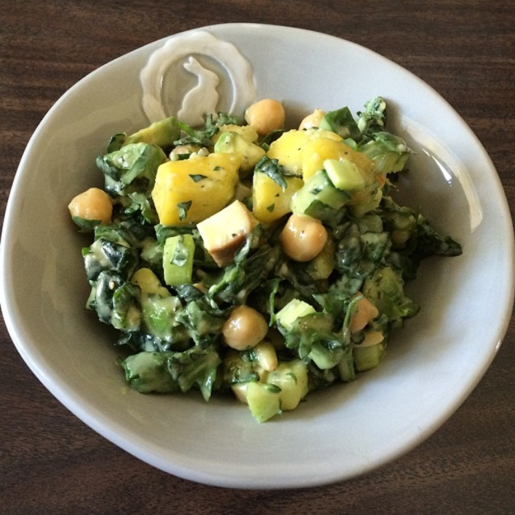 This green salad has kale, arugula, cucumber, celery, avocado, chickpeas, smoked tofu, mango, pine nuts and hemp seeds with a tahini lime dressing.