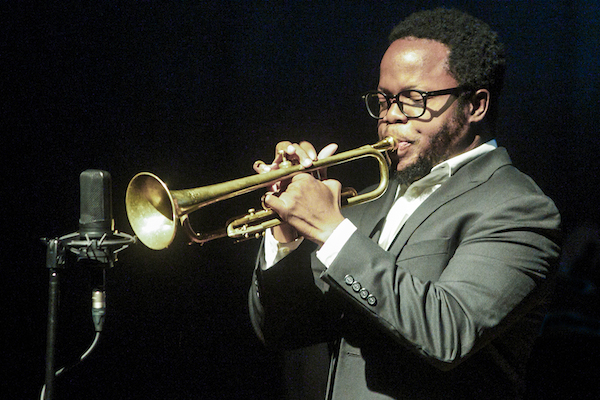 "Ambrose Akinmusire unveils his new multimedia project, ""Banyan,"" at the Hyde Park Jazz Festival in Chicago on Sept. 26. (Photo: Michael Jackson)"