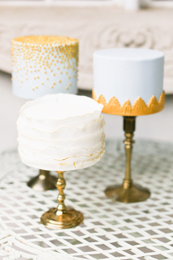 15. collection of mini gold wedding cakes  by flour and flourish - utah