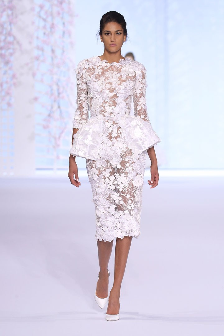White Chantilly lace peplum dress appliquéd with 3D silk organza cutwork flowers, crystals and feather petals.
