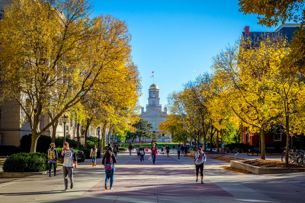 Students walking to class on the campus of University of Iowa in a sunny fall day, Oct. 2015