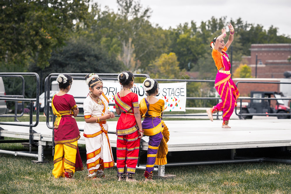 A grorup of young performers waiting to perfomr at the annual Celebrating Cultural Diversity Festival in downtown Iowa City, Oct. 2015.