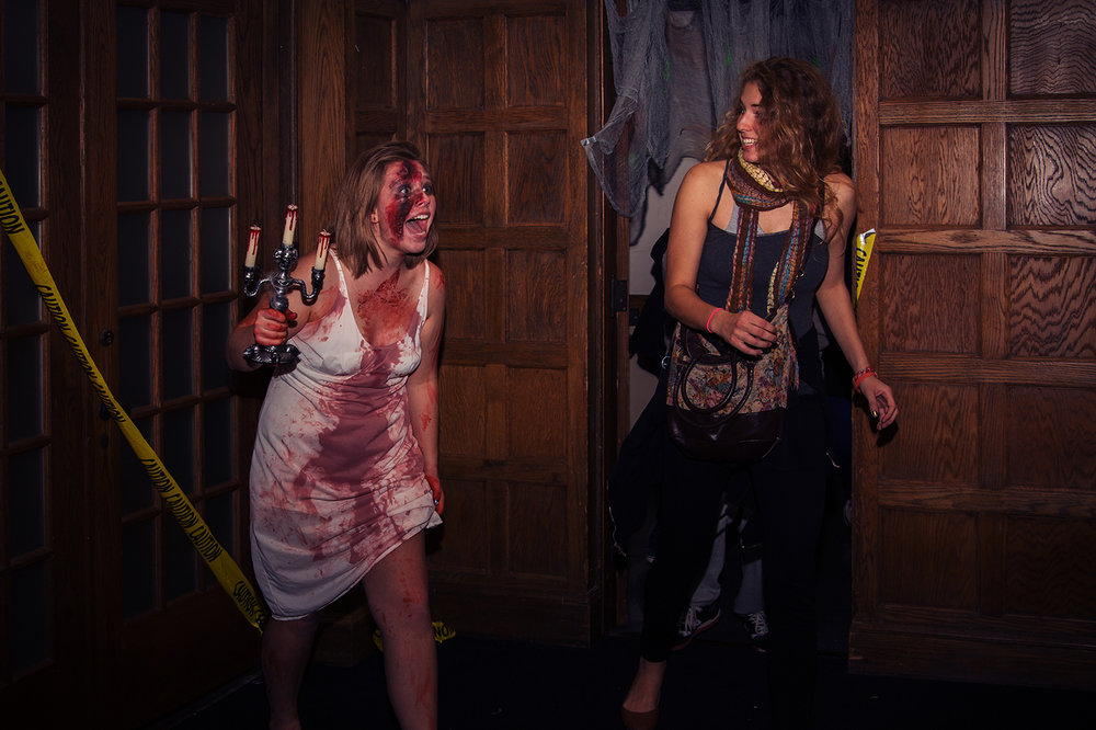 A student actress scaring event-goers at a haunted house event at University of Iowa, Nov. 2013.