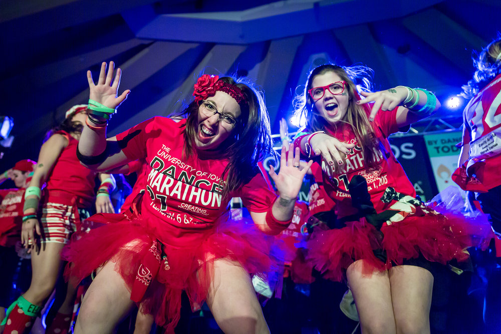 Two students participating in the Big Event of Dance Marathon 21 at Universiy of Iowa, where students remain standing for 24 hours to raise money and awareness for children with cancer, Feb. 2015