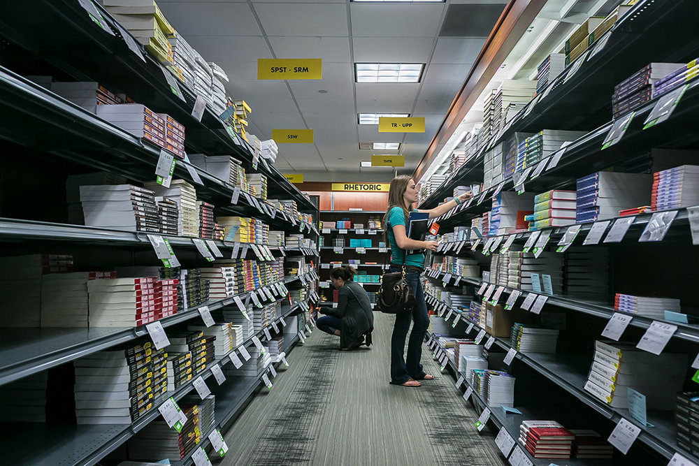 Students purchasing textbooks for the new semester at a bookstore in downtown Iowa City, Aug. 2015.