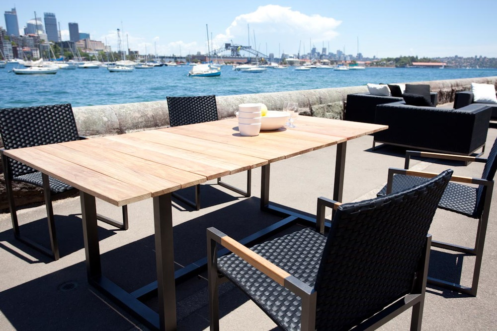Coast dining table and Coast Carver Chair from Harbour Outdoor