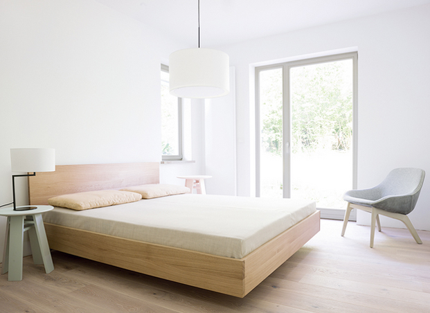 Zeitraum Noon Table Lamp, Morph Lounge chair, Bondt Side table, and Simple HI Bed from Zeitraum