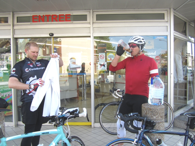 Next refreshment stop, no time to sit down! Grab supplies from the supermarket, loo break and back on the bikes