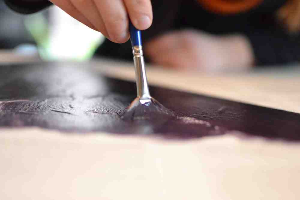 Purple_triangle_being_painted_hand_close_up_small.jpg
