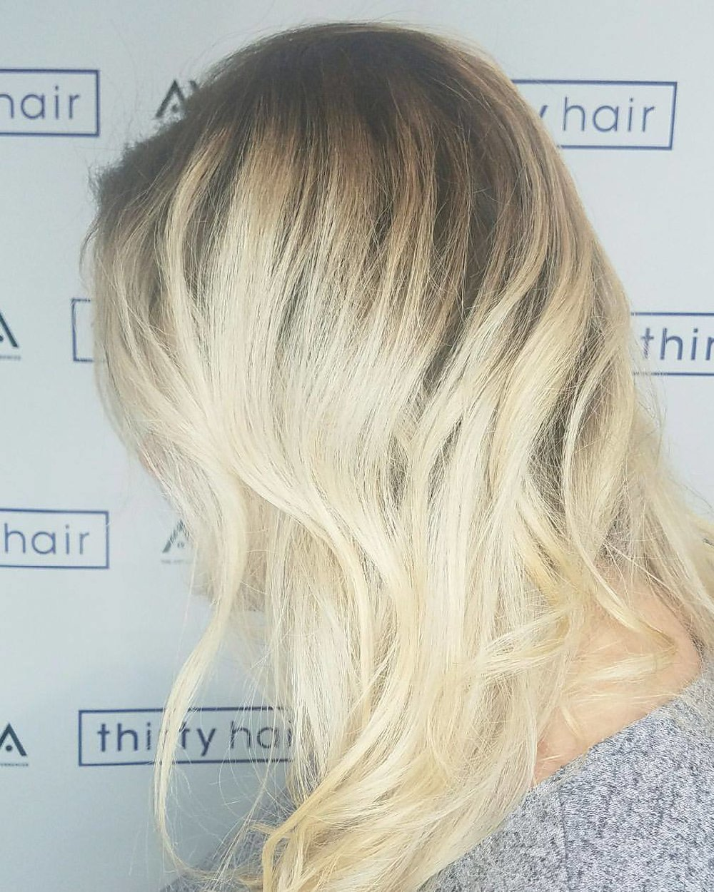ash shadow root with blond balayage