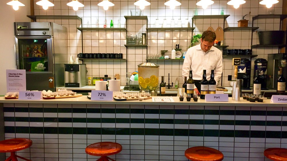 "Image: Brian Vogt prepping samples for a ""Chocolate + Wine 101"" that Brisan and Prova presented at WeWork Fulton Market in April 2016."