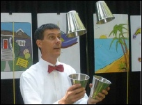 K-3 students learn the basics of budgeting with juggling cups: 'Now,' 'Soon,' 'Later' and 'Share'