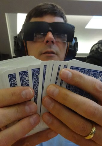 Brad memorizing a deck of shuffled playing cards at the World Memory Championships, wearing noise canceling headphones and a custom-made eye maskto block out distractions. His current personal best at memorizing a deck of cards: 58 seconds in training, 85 seconds in competition.