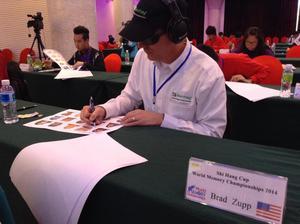 Memorizing names and faces at the World Memory Championships 2014 in China.