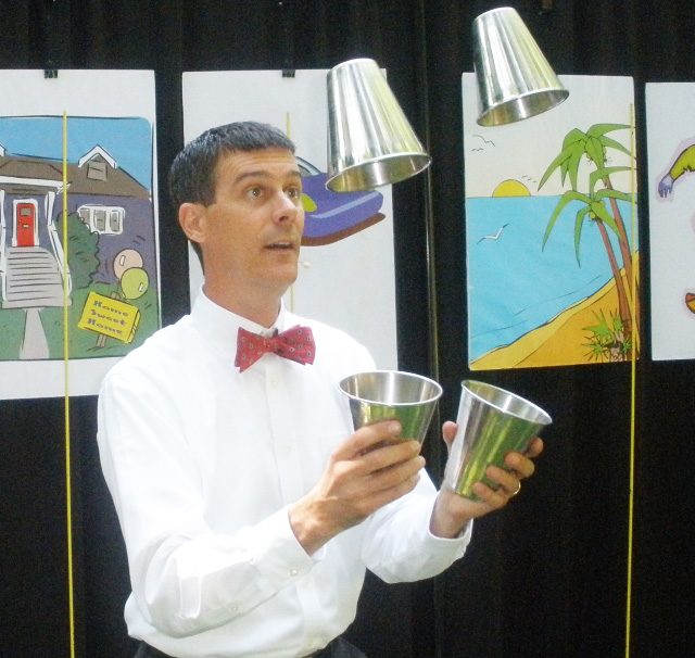 Juggling cups help all ages understand budgeting with Now, Soon, Later, and Share.