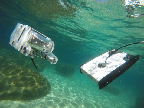 "Latest version of the ""OpenROV"" on the left and prototype ""Trident"" with a scheduled release in Nov. of 2016 on the right."