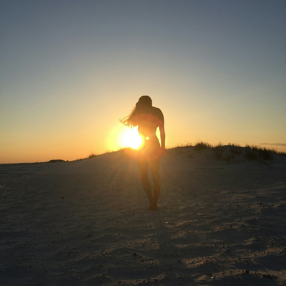 Our Swimwear with the Sunset on Pensacola Beach, Florida, USA