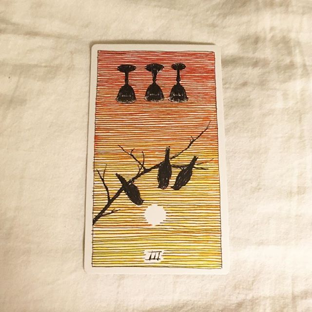 #theoctobertarot, Day 25: Honoring the Dead  For Shirley —— Three of Cups, reversed / isolation, but also independence; refusing to sacrifice your own passions for the group; lost connections (plus the shadow of the sisterhood, kinship, and support from the un-reversed reading, and with the birds in this deck, I can't help but think, one for sorrow, two for joy, three for a girl...)
