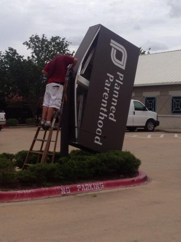 Former Bryan Planned Parenthood Clinic Sign Being Taken Down.