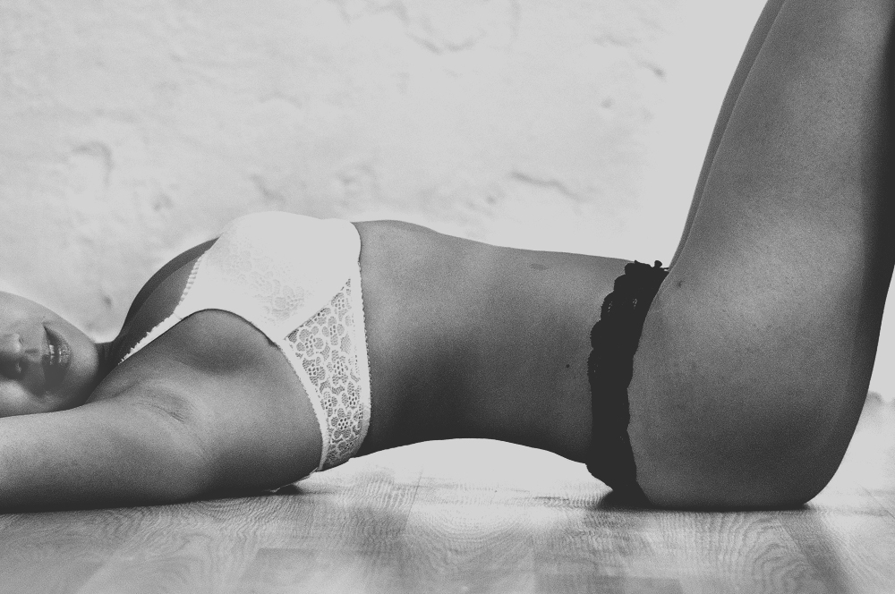 black & white laying on floor boudoir.jpg