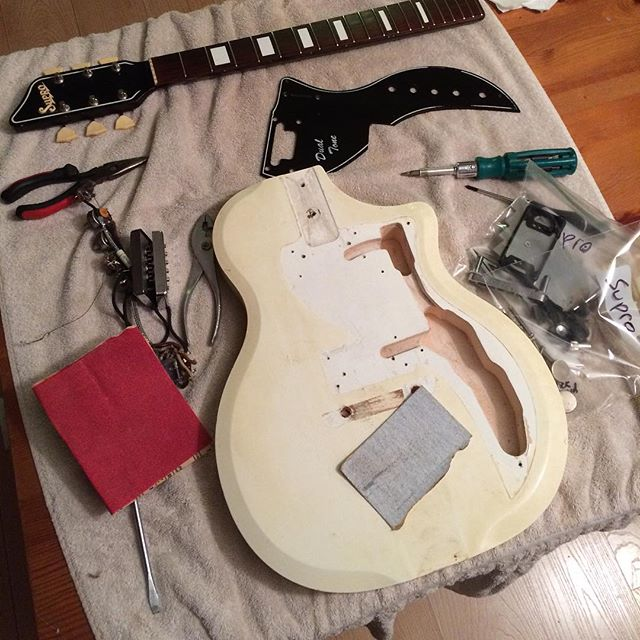 Charlie's working on restoring his '58 Supro. Lot left to do but it will be a sweet guitar when it's done. #luthier #guitarrestoration #frenchgirls