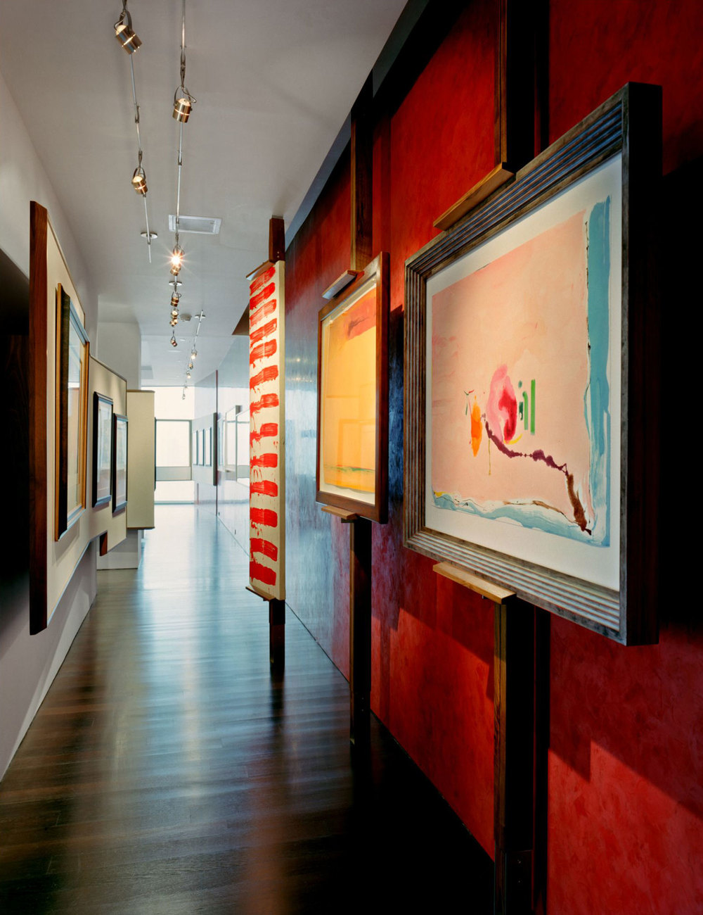 A project of discreet interventions with furniture and cabinetry to offset the overwhelming whiteness of being. A deep red Venetian plaster wall greets ones arrival and extends the length of the space to the open living room. Easels and wall panels are set up to accommodate an ever changing collection of contemporary painting.