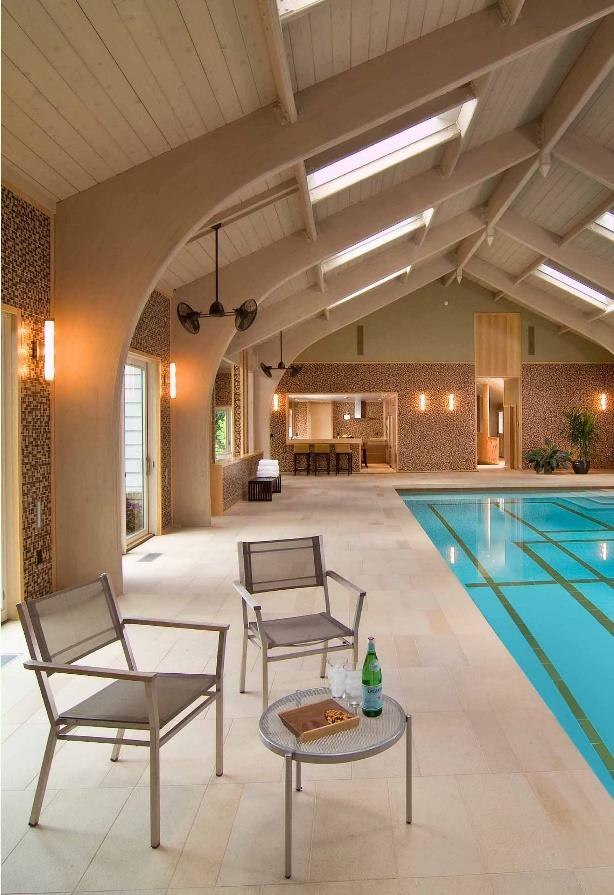 Liked by tunnel from the main house, the primary space is the indoor pool, surrounded by 10 sliding doors