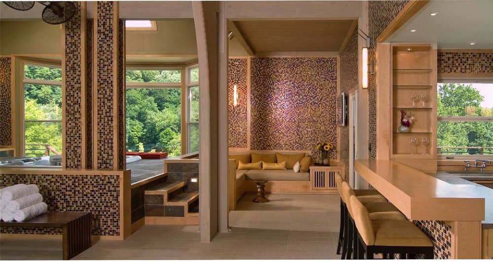 SUPPORTING FACILITIES OF SAUNA, STEAMROOM,  Liked by tunnel from the main house, the primary space is the indoor pool, surrounded by 10 sliding doors and resurfaced in an aggregated mosaic glass tile. The supporting facilities of sauna, steam room, and weight room were built as extensions. The walls were resurfaced in an aggregated mosaic glass tile.