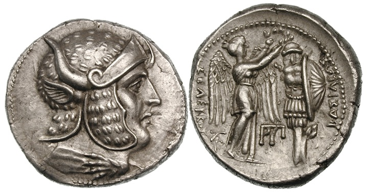 A coin minted after 301 BCE which appears to show Alexander with  features associated with Dionysus , such as a panther-skin helmet and the horns and ears of a bull.
