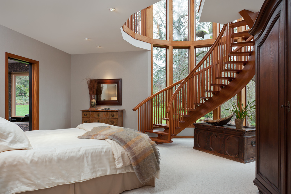 Hand-crafted teak spiral staircase. Coval House. Mercer Island, Washington
