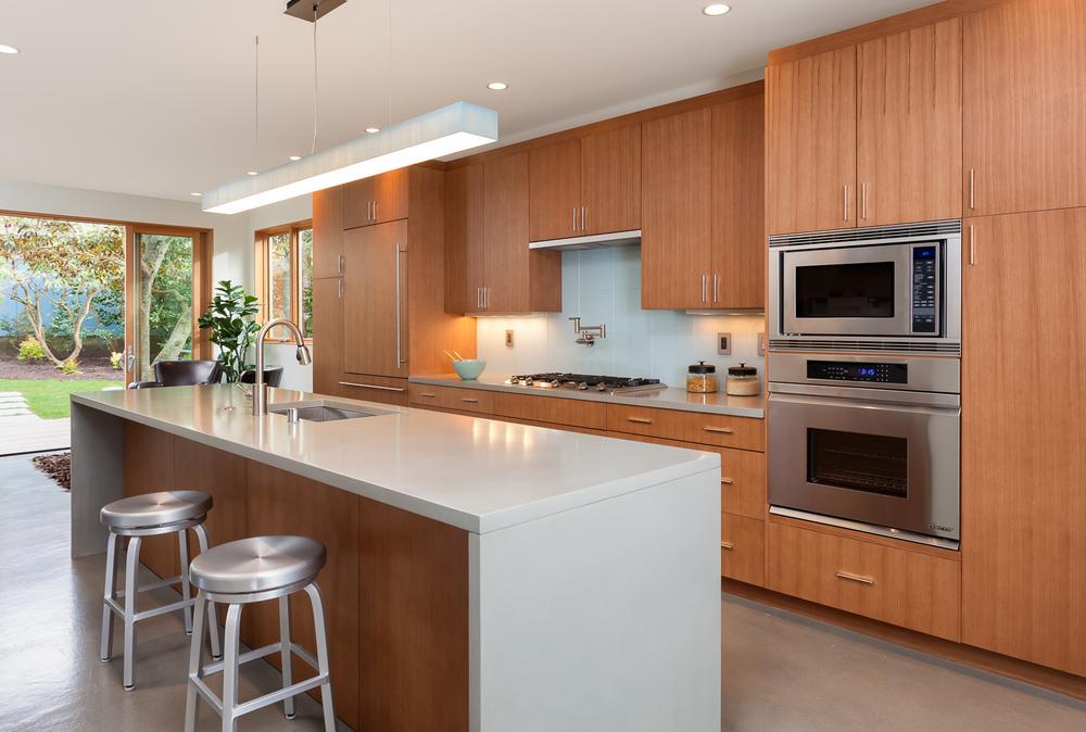 Contemporary kitchen opening to garden space. Seattle, Washington