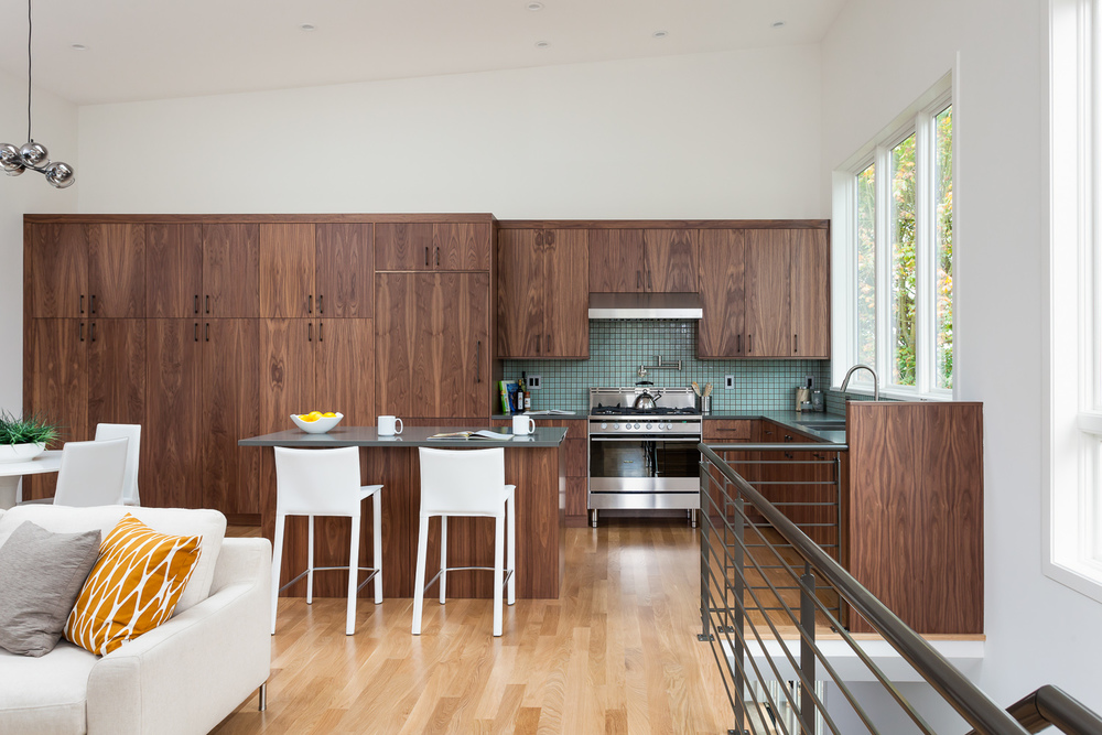 Open-plan living space in modern design-build home. Maple cabinetry. Seattle, Washington