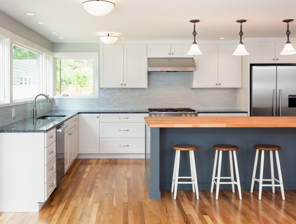 Kitchen remodel. Cabinetry, tile backsplash, stone countertops, oak flooring. Mercer Island, Washington