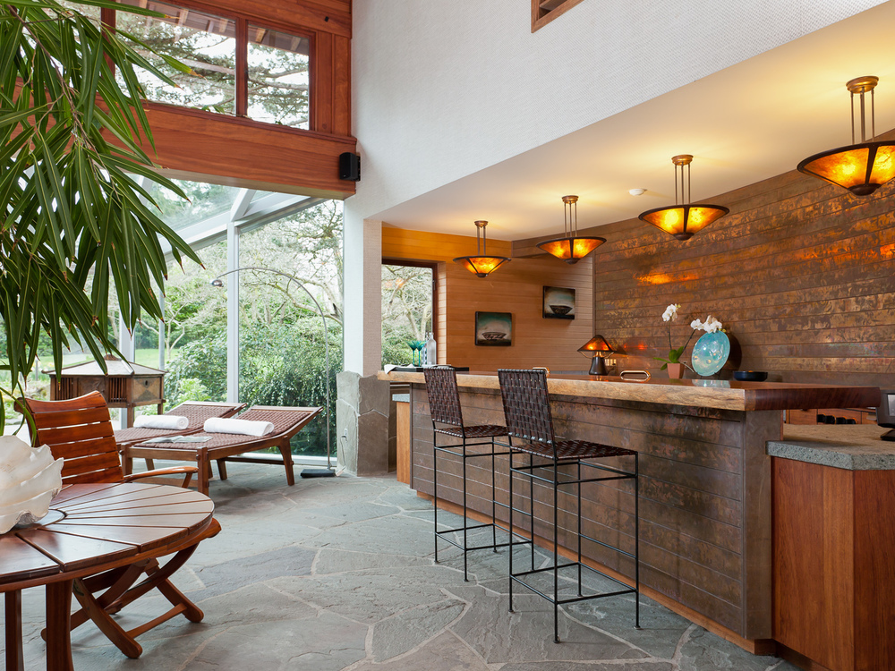 Pool room bar. Copper wall and bar face. Bubinga wood bar top. Coval House. Mercer Island, Washington