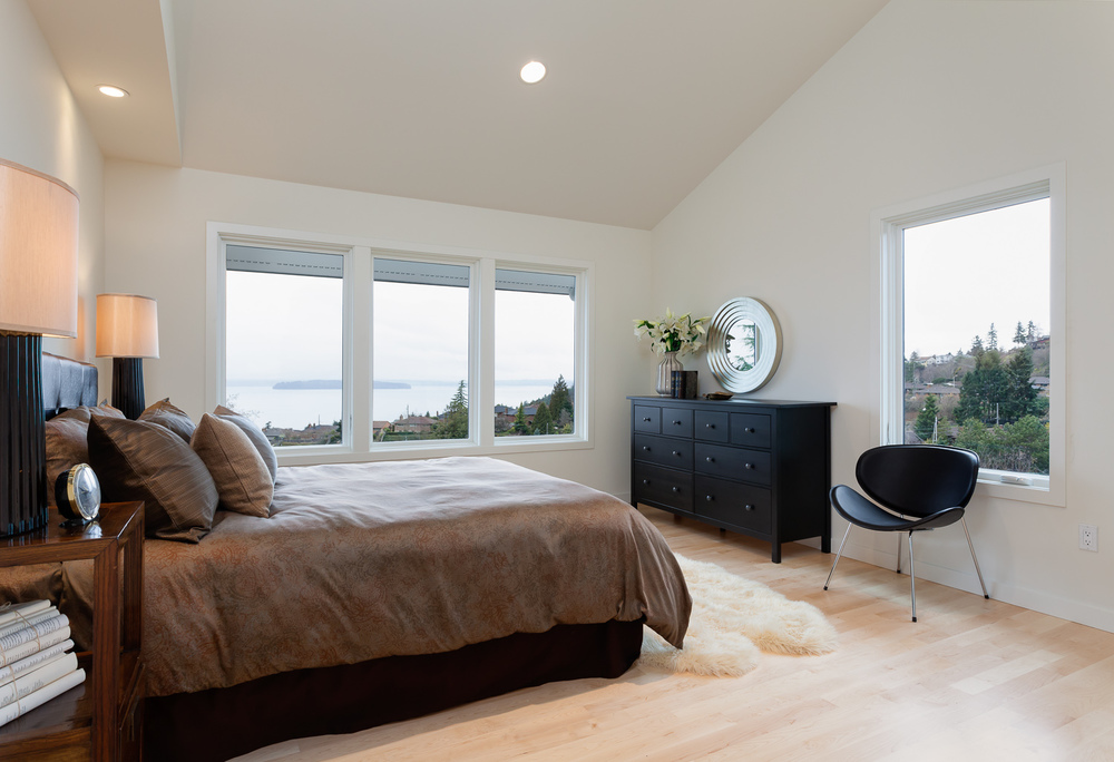Master bedroom with Puget Sound view. Full-scale home remodel. Seattle, Washington