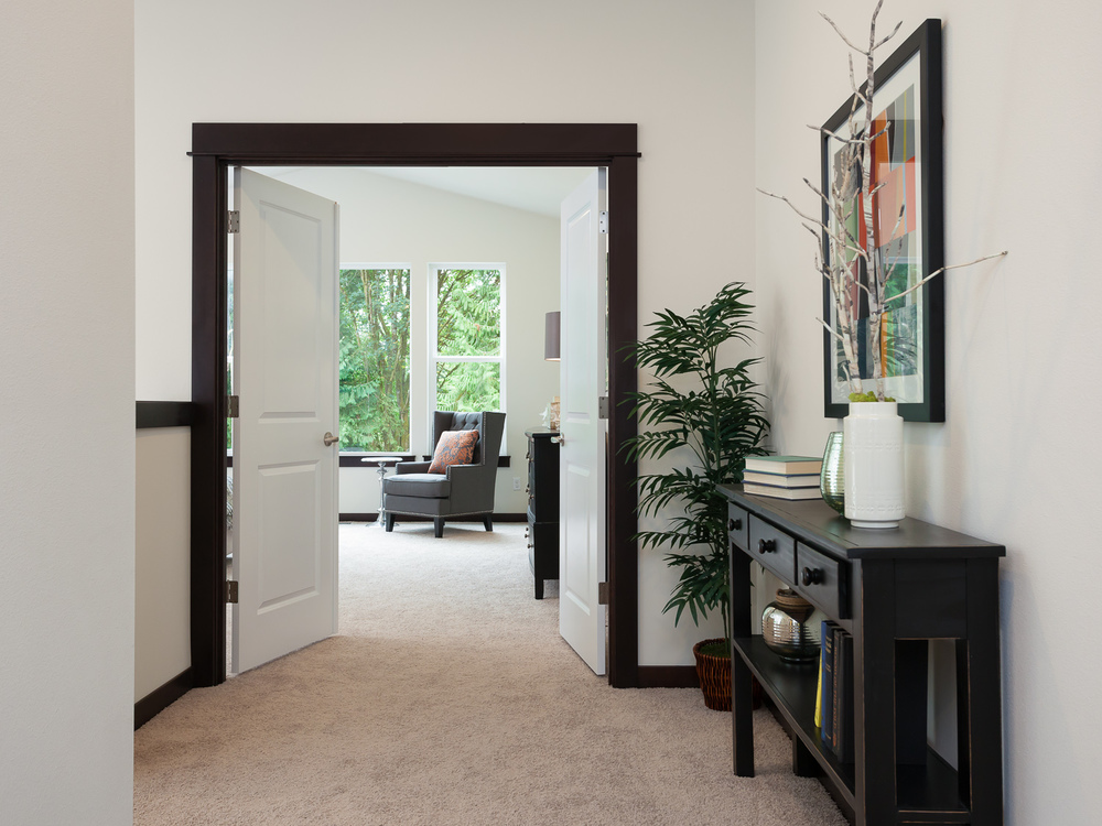 Double doors opening to master bedroom. New construction. Woodinville, Washington