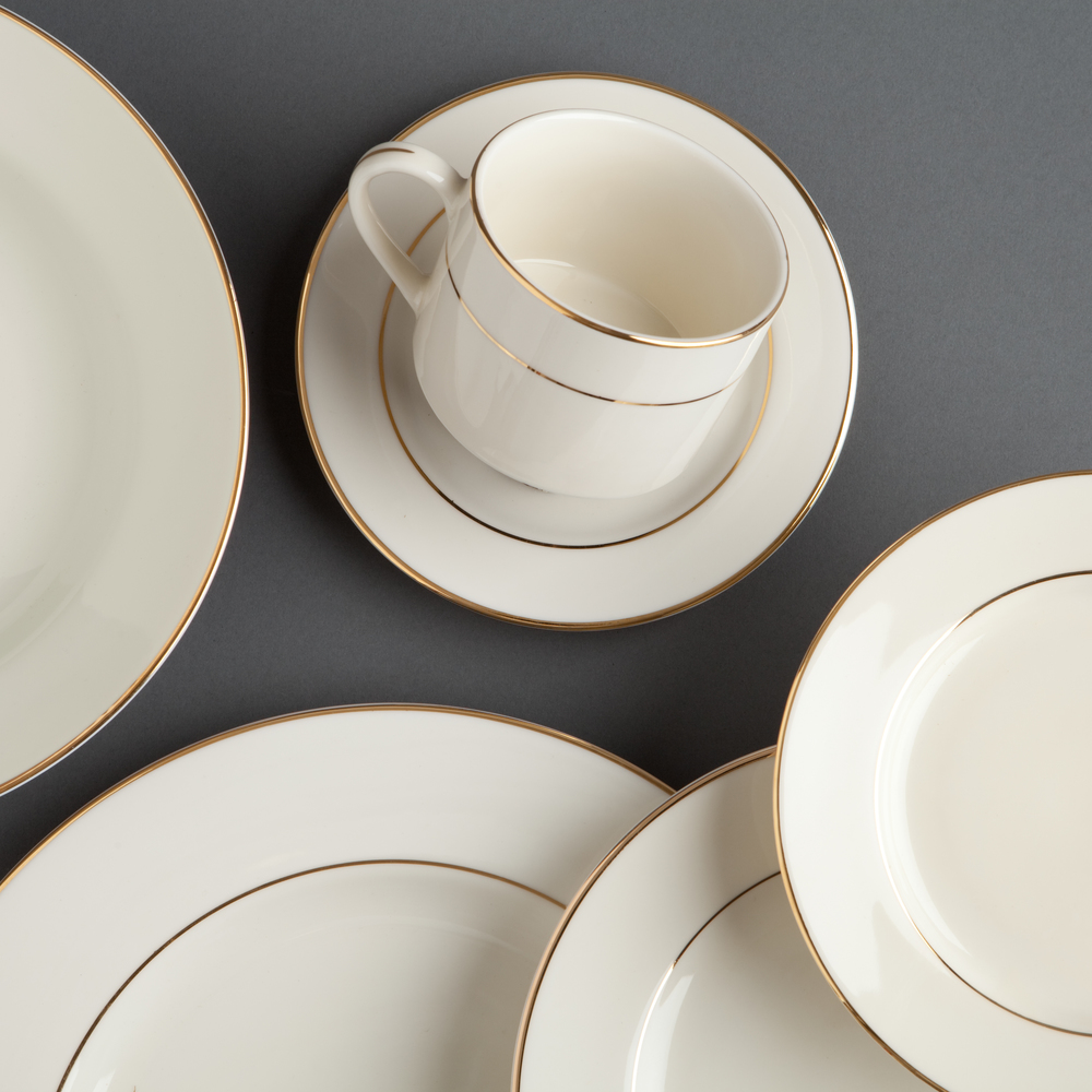 Unity China - A longstanding favorite, our Gold-Rimmed China in off white adds warmth and elegance to your guest tables.
