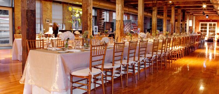 Mass Moca banquet tables Gold chairs .jpg