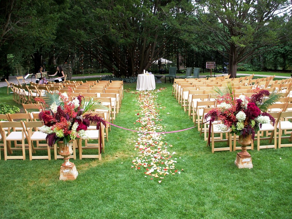 Wheatleigh ceremony natural chairs.jpg