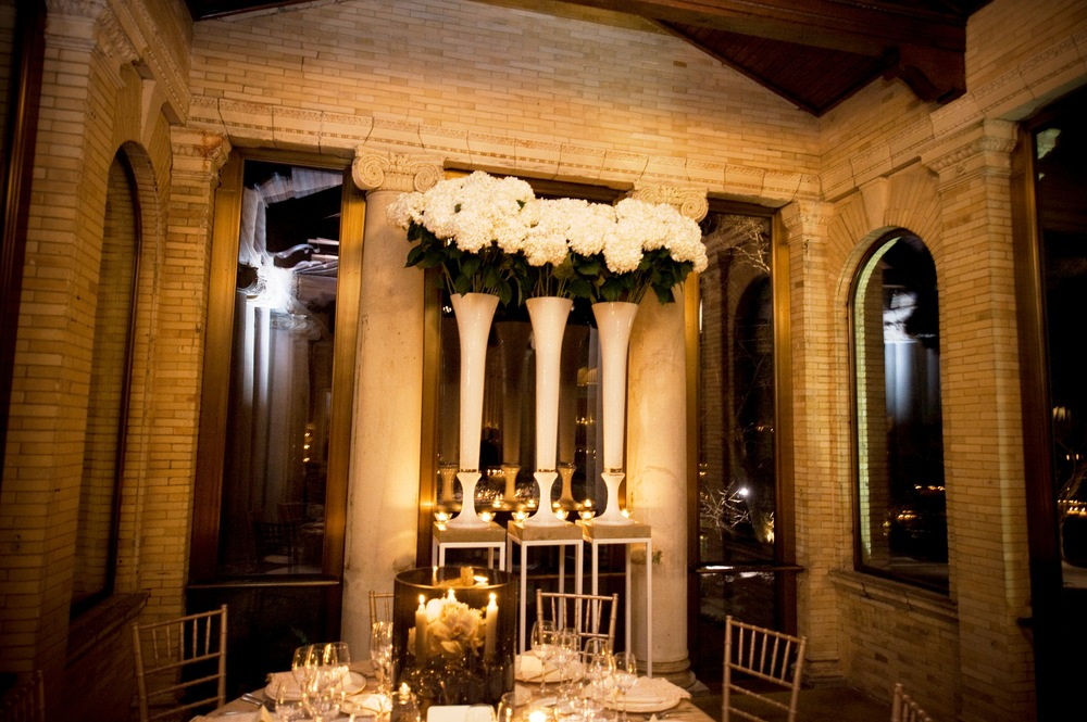 Wheatleigh reception gold chairs tall flowers.jpg