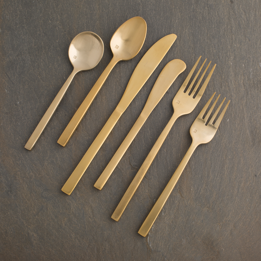 Savoy Brushed Gold Flatware - Sassy and up to date, our brushed gold flatware was a hit from day one! Rent this line for your modern wedding or event.