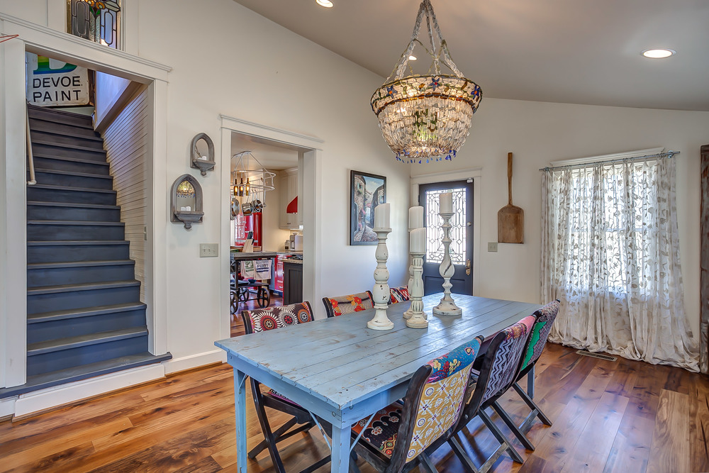 The spacious dining room in the Tin Roof Cottage features an original farm table and ample room for family fun and dining | Pot N' Kettle Cottages