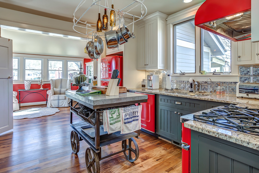 Industrial style finds and pops of red make the kitchen a show stopper at the Tin Roof Cottage | Pot N' Kettle Cottages