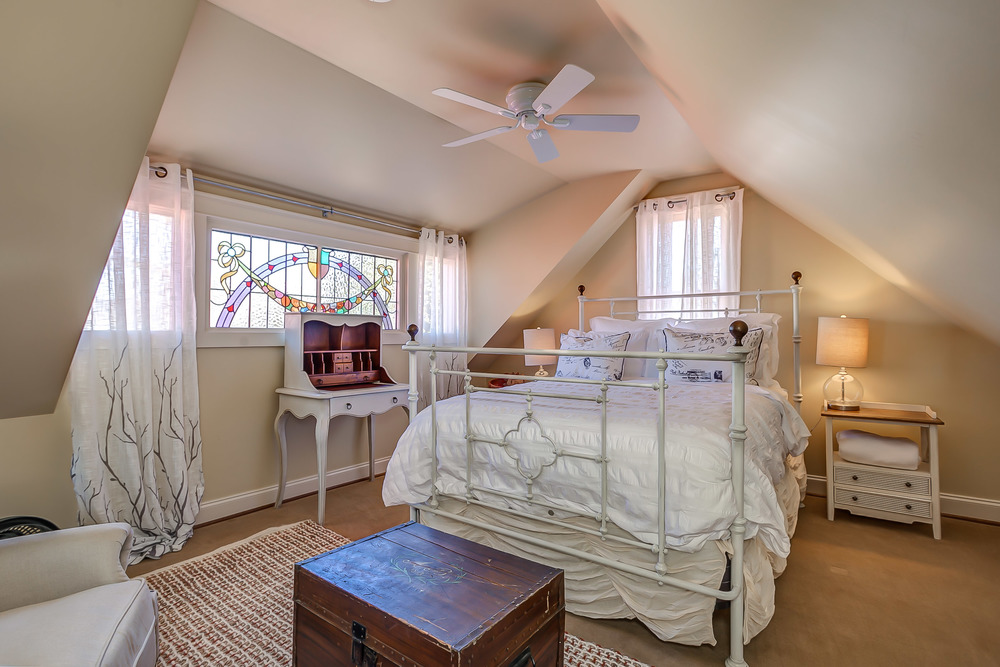 The deluxe queen in the Tin Roof Cottage bedroom is soft and cozy for a restful nights sleep | Pot N' Kettle Cottages