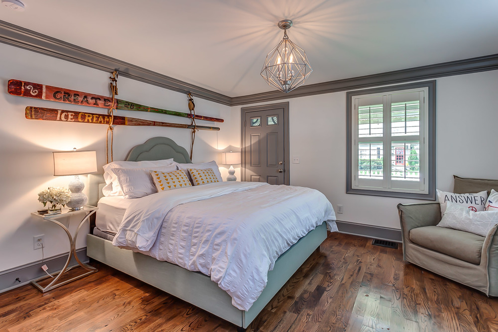 The master suite at the Pickers Cottage is designed with fun vintage finds | Pot N' Kettle Cottages
