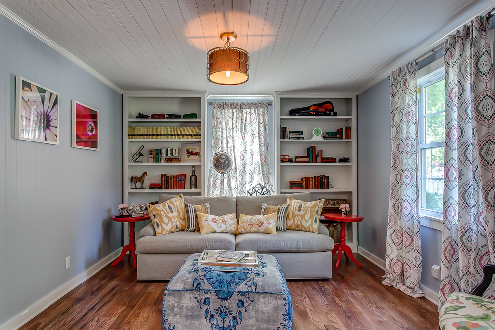A queen sleeper sofa is tucked away into the library for extra guests at the Coda Cottage | Pot N' Kettle Cottages