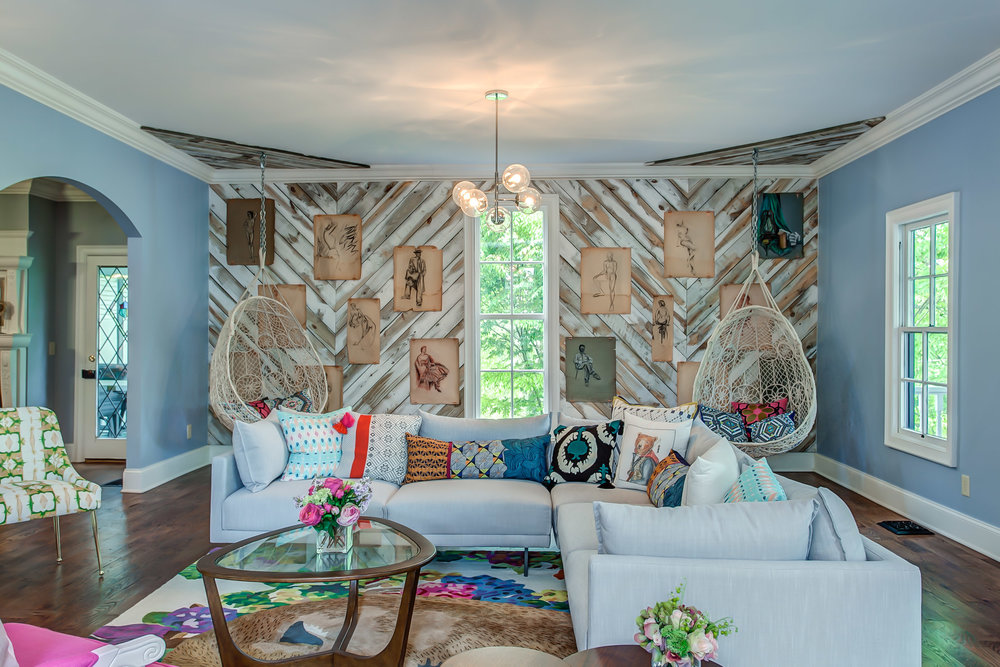 A large sectional sofa in the living room of the Leiper's Fork Inn offers relaxation and room for hanging out | Pot N' Kettle Cottages