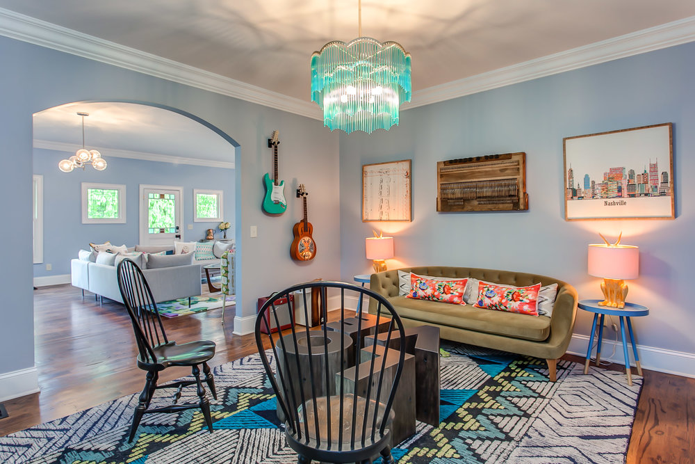 The unique chandelier in the music room sets the vibe for family and friends entertaining at the Leiper's Fork Inn | Pot N' Kettle Cottages