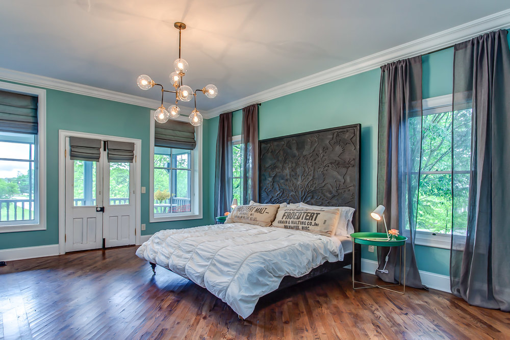 The master suite at the Leiper's Fork Inn features a fireplace | Pot N' Kettle Cottages