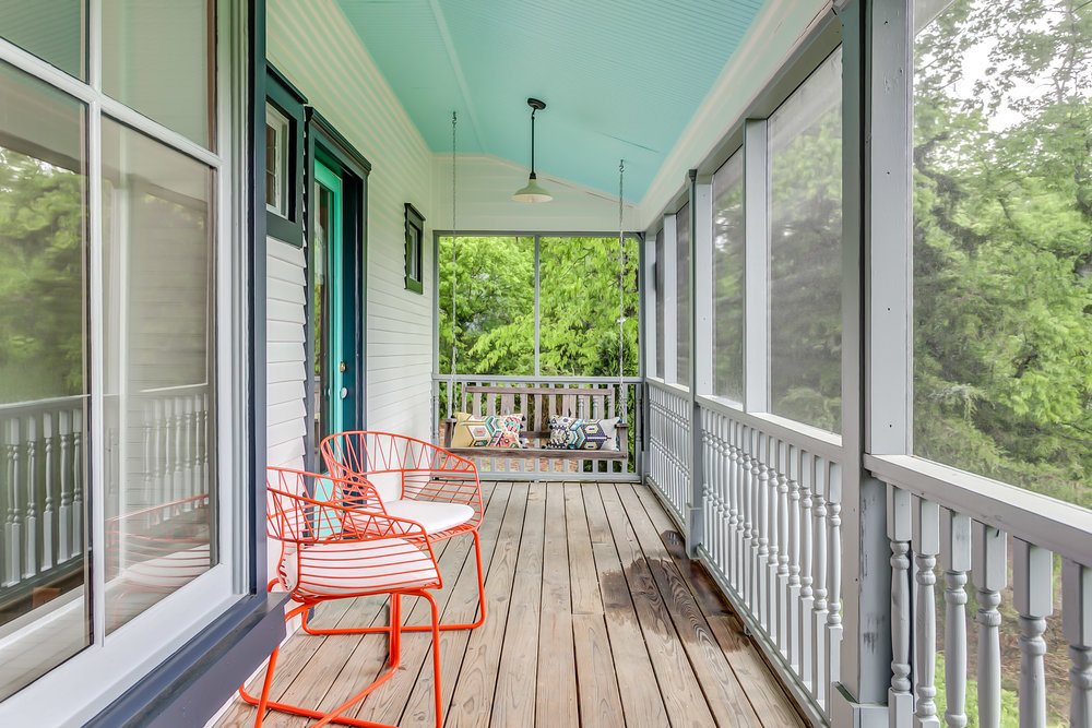 Spacious country porch for sweet tea sipping at the Leiper's Fork Inn | Pot N' Kettle Cottages